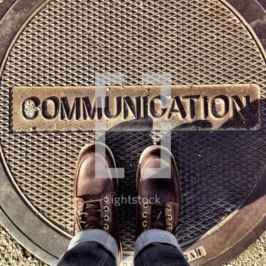 word communication on a manhole cover