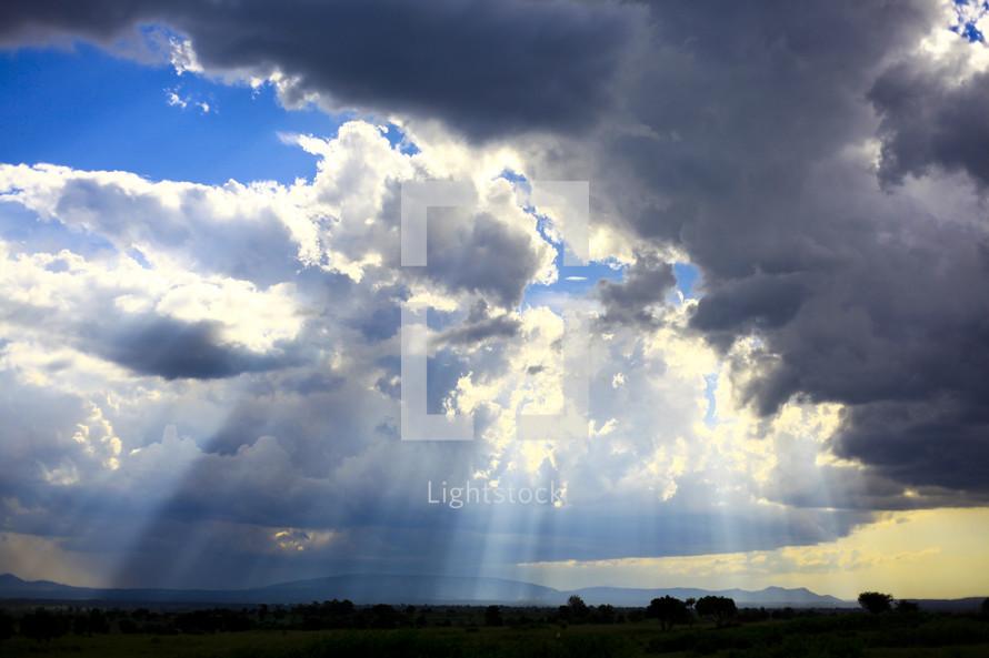 Sun beaming through clouds