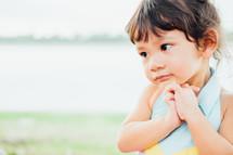 toddler girl with praying hands