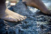 bare feet on rock
