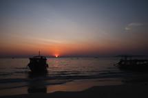boats along a shore at dusk
