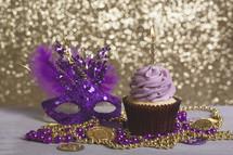 cupcake and mardi gras beads