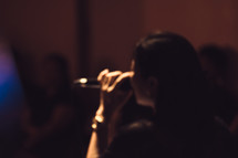 a woman singing into a microphone