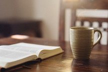 open Bible and a coffee mug
