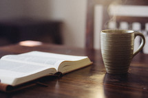 open Bible and coffee mug