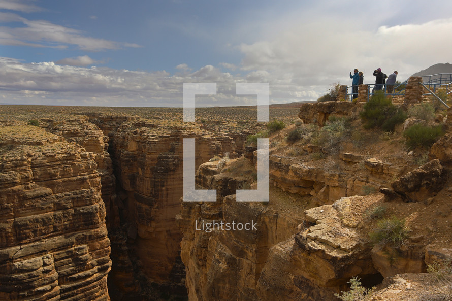 tourists at a canyon lookout
