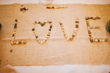 the word 'love' spelled out with rocks - Valentines Day