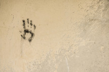 Handprint on wall