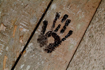 Native hand print on wooden door