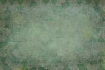 A background of triangles in shades of green./