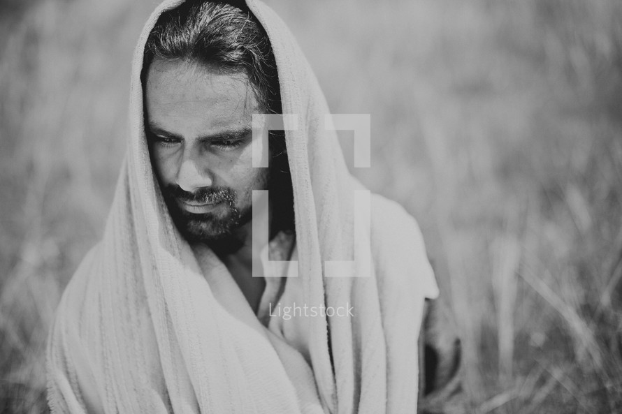 Jesus thinking alone in a field