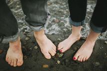 bare feet at waters edge