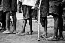 boy standing in line with crouches