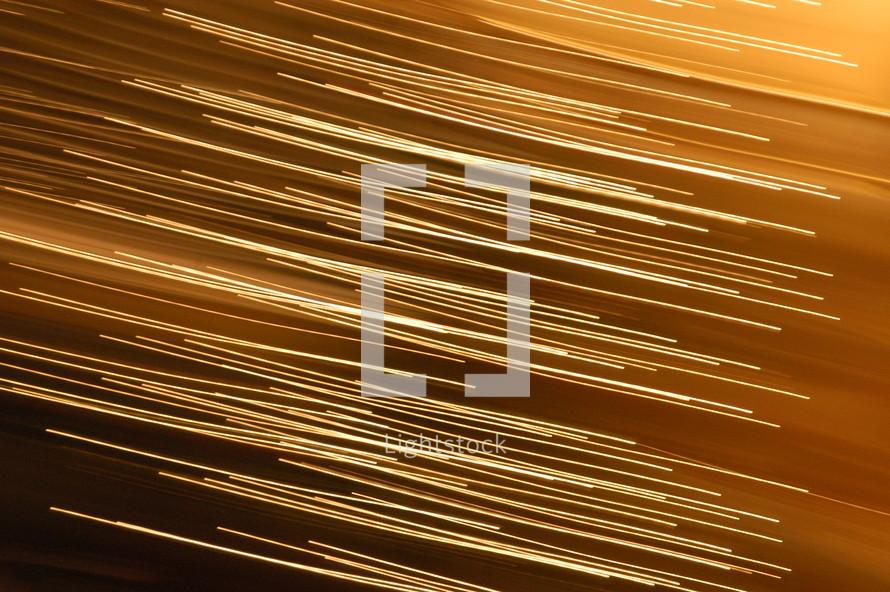 streaks of lights across a brown background