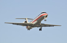 Commercial airplane with its landing gear down. Jet passenger aircraft. American Airlines.
