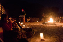 sitting around a campfire at night in the desert