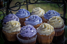 purple and white icing on a cupcakes