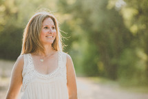 Smiling woman walking outside.