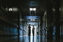 doctors talking in a hospital hallway