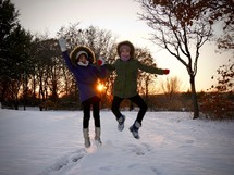 kids jumping in snow