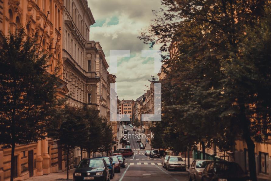 downhill street through a European city
