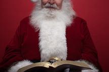 Santa reading a Bible