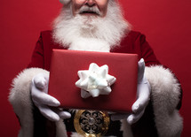 Santa holding a Christmas gift
