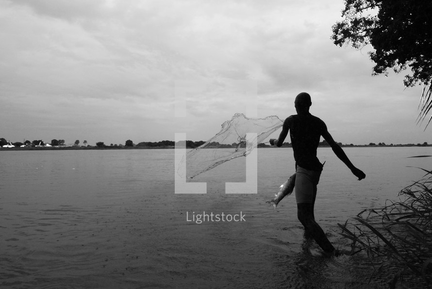 Southern Sudanese fisherman casting his net on the banks of the River Nile.