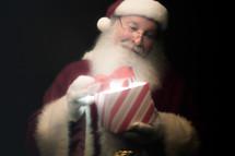 Santa opening a magical gift