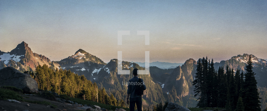 A man standing on Mount Rainer