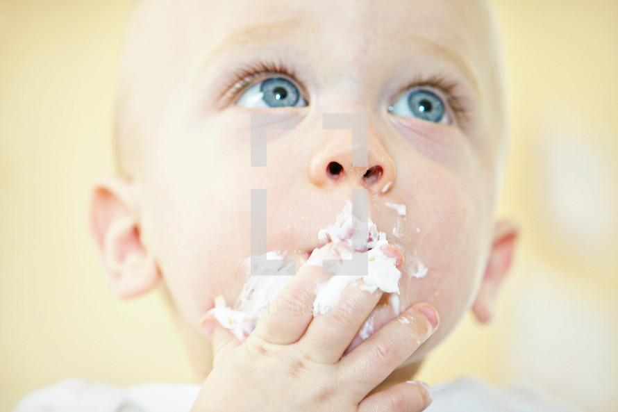 Baby eating whip cream