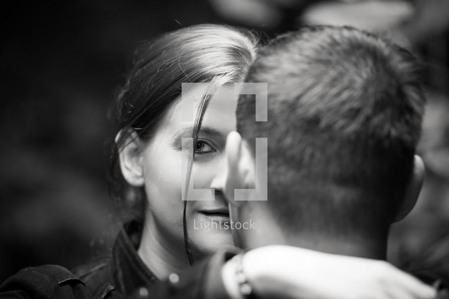 head shot of girl facing boy
