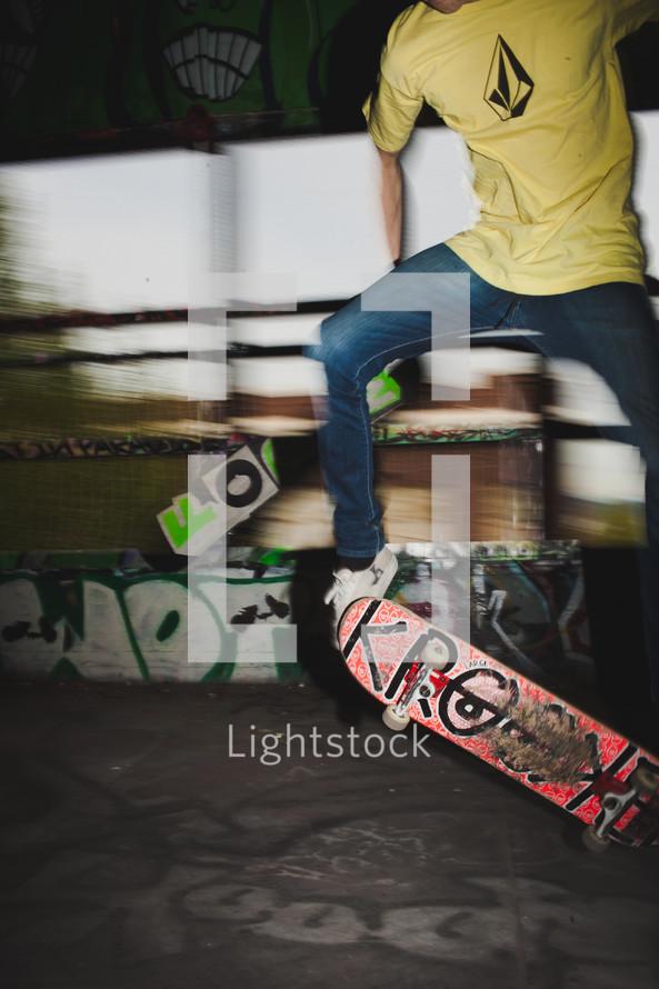 teen boy doing a trick on a skateboard