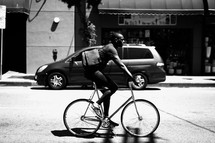 African American man riding a bicycle