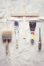 stir sticks, paint brush, screw driver, tarp, paint supplies, painting, home improvement