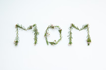 word mom in flowers and leaves