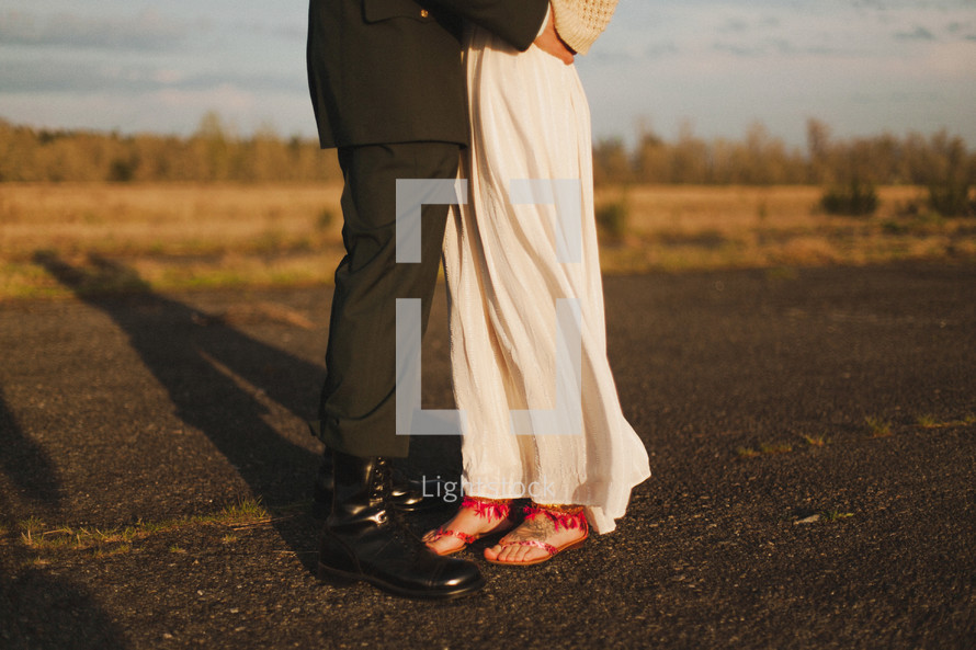 feet of a woman and serviceman
