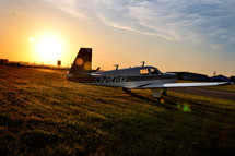 A small plane on a field of grass.