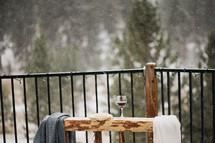 communion wine and bread on outdoor altar under snow fall