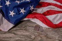 American flag and dog tags on wood
