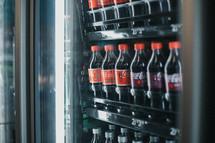 cokes in a refrigerator