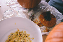 taking seeds out of a pumpkin