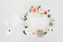wreath around invitations for a wedding