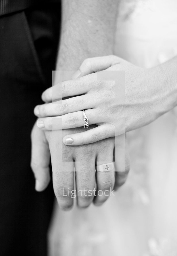 wedding bands and holding hands