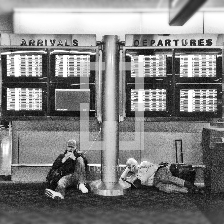 Arrival and departure signs in an airport