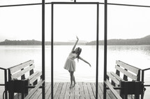 woman dancing on a dock