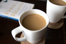 coffee mugs and Proof of Heaven book