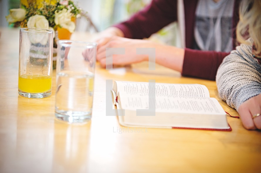 teens reading a Bible at a Bible study