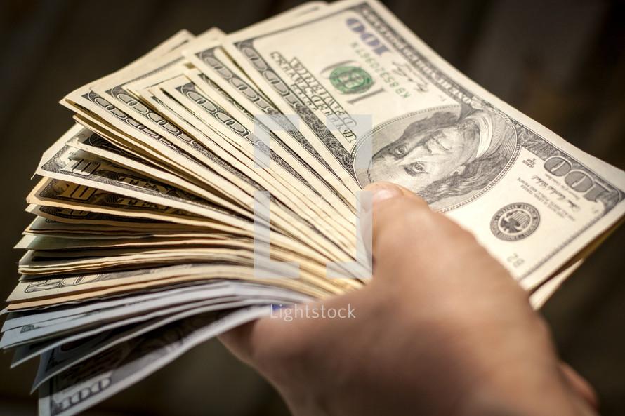 man holding a large amount cash