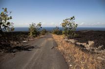crumbling broken road to an African beach